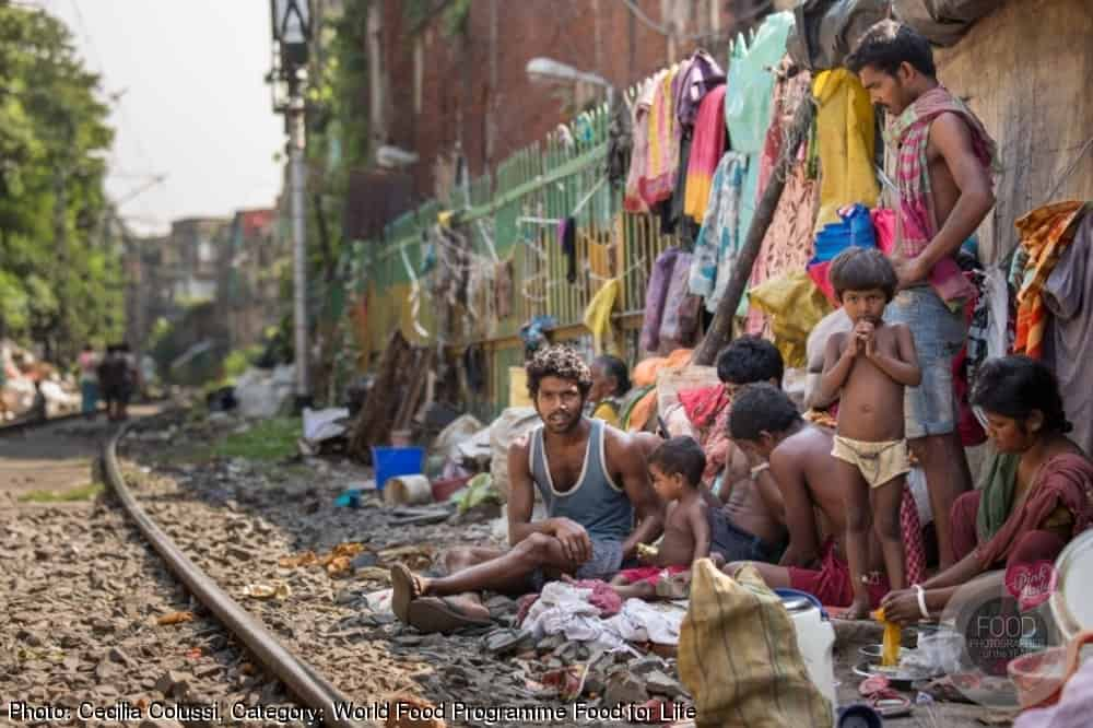 Family living in the slums along the rail in Northern Kolkata, West Bengal, India