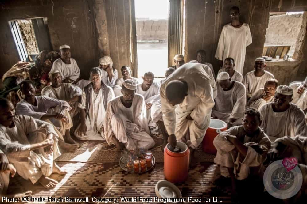 Tribal Leaders gather to discuss the severity of the ongoing drought. Water dyed with orange food colouring is handed out to the parched men who eagerly sip at their cups.